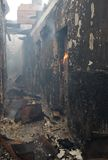 Fire in a building. The destroyed building destroyed by the burning down fire Royalty Free Stock Images