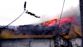Fire in the building. The roof of the building on fire. The fire in the building. The roof of the building on fire stock footage