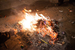 Fire built out of spent fireworks Royalty Free Stock Photo