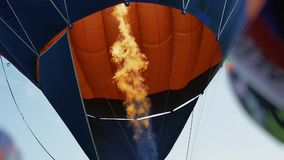 Fire from burner inflates hot air balloon. Flame tongue. stock video footage