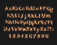 Fire burning alphabet and numbers font. Set with smoke on black background Stock Photos