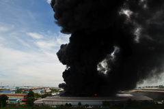 Fire burning and black smoke over cargo Stock Images
