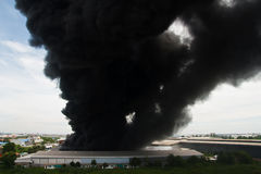 Fire burning and black smoke over cargo Stock Photography