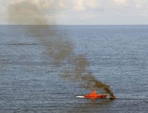 Fire burning on the boat,. Fire burning on the small boat, rescue ship Royalty Free Stock Photo