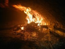 Fire burning in a brick oven stock photos
