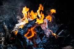 Fire burning. In a burn pile Royalty Free Stock Images