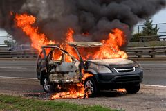 Fire burning car stock photos