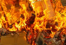 Fire of burning carton paper. Red fire of burning carton paper stock photography