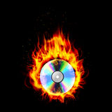 Fire burning CD black background Royalty Free Stock Images