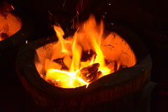 Fire burning charcoal in stove. Stock Photography