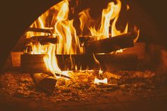 Fire in mantelpiece. Fire burning in the chimney, cozy sweet home concept Stock Photos