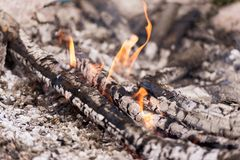 Fire burning down in the early evening stock images