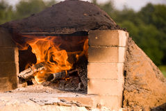 Fire burning in earthen oven Royalty Free Stock Photography