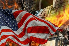 Fire burning in the engulfs small house and the American Flag. Fire burning and destroyed home in the engulfs small house and the American Flag royalty free stock photo