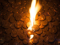 Fire burning on euro coins Stock Photography