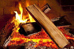 Fire burning in fireplace. Closeup of a wood fire in a fireplace royalty free stock photos