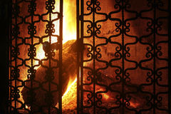 Fire burning in fireplace. Bright and colorful wood-burning fire lit in a fireplace Stock Photo