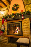 Fire burning in a fireplace decorated in Christmas style Royalty Free Stock Photos