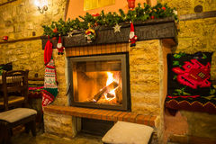 Fire burning in a fireplace decorated in Christmas style Stock Photo
