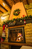 Fire burning in a fireplace decorated in Christmas style Stock Image