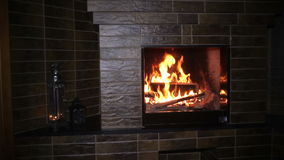 Fire burning in the fireplace in the evening on Christmas stock footage