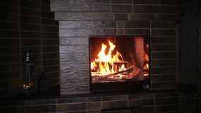 Fire burning in the fireplace in the evening on Christmas stock video