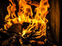 The fire is burning in the fireplace. Burning firewood. Stock Images
