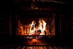 Fire burning in fireplace Royalty Free Stock Images