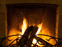 Fire burning in the fireplace. Log burning in the fireplace chamber, closeup Royalty Free Stock Photos