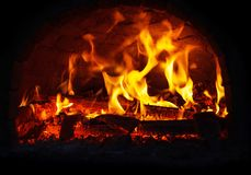 Fire burning in the fireplace. stock image