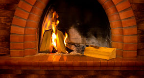 Fire burning in the fireplace Stock Image