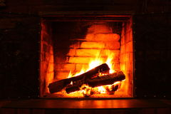 Fire in burning fireplace in winter close-up stock images