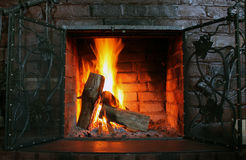 Fire in burning fireplace in winter close-up Royalty Free Stock Images