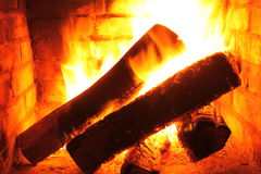 Fire in burning fireplace in winter close-up stock image