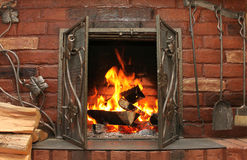 Fire in burning fireplace in winter close-up Royalty Free Stock Photography