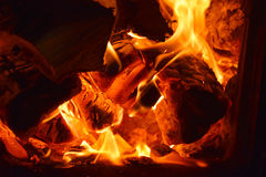 Fire burning in the furnace Stock Images