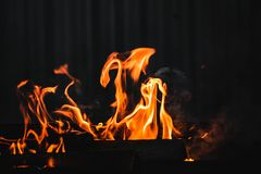 Fire burning on the grill Royalty Free Stock Images