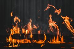 Fire burning on the grill Royalty Free Stock Photos