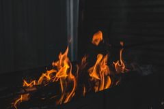 Fire burning on the grill Royalty Free Stock Image
