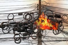 Fire burning High Voltage Cables power, Danger wire tangle cord electrical energy. Fire is burning at High Voltage Cables power, Danger wire tangle cord royalty free stock images