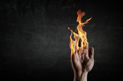 Fire burning in his hands. Young businessman holding fire flames in palm Stock Photo