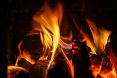 Fire burning inside a brick stove Royalty Free Stock Photo