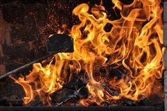 Fire and burning log. Fire flames with logs and dark background stock photo