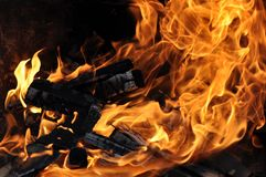 Fire and burning log. Fire flames with logs and dark background royalty free stock images