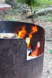 A fire burning in a metal fire ring.  Royalty Free Stock Image