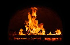 Fire burning in the fireplace. royalty free stock photography