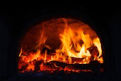 Fire burning in the fireplace. stock photos