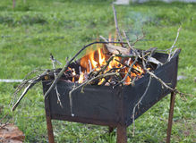 The fire is burning in the old grill. Royalty Free Stock Image
