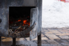 Fire burning in a potbelly stove Stock Images
