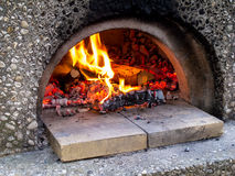 Fire burning in red oven Royalty Free Stock Images
